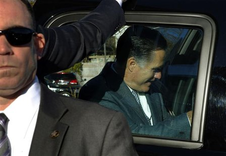 Republican presidential nominee Mitt Romney gets into his vehicle after voting in Belmont, Massachusetts November 6, 2012. REUTERS/Brian Sny