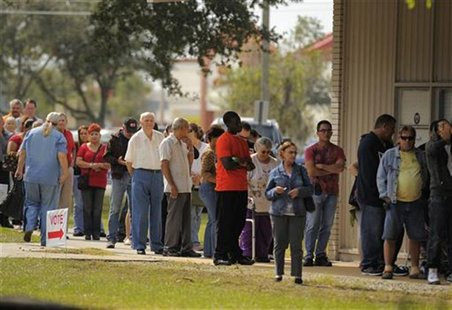 People wait to vote at the St. John's Episcopal Church during the U.S. presidential election in Kissimmee, Florida, November 6, 2012. REUTER