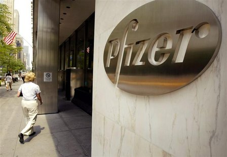 A woman walks into the Pfizer Inc. world headquarters building July 15, 2002 in New York City. REUTERS/Jeff Christensen JC