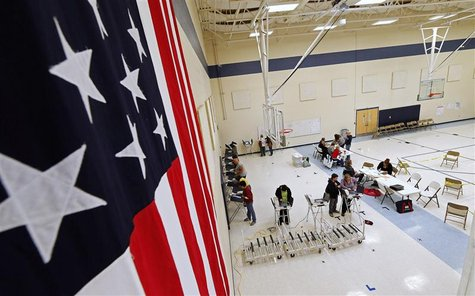 Voters cast ballots at a polling station at Freedom Academy in the U.S. presidential election in Provo, Utah, November 6, 2012. REUTERS/Geor