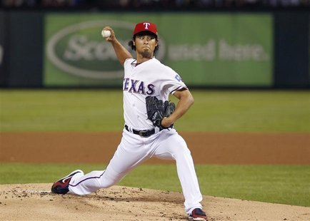 Texas Rangers pitcher Yu Darvish throws against the Baltimore Orioles in the first inning of their MLB American League Wild Card playoff bas