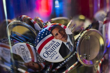 Buttons with portraits of U.S. President Barack Obama lie in a glass bowl during the U.S. election night at the representation of the Bertel