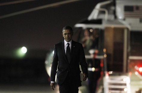 U.S. President Barack Obama walks to Air Force One at JFK Airport October 18, 2012, after attending the 67th Annual Alfred E. Smith Memorial