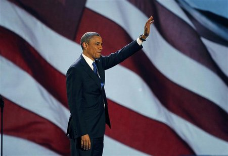 U.S. President Barack Obama, who won a second term in office by defeating Republican presidential nominee Mitt Romney, waves as he addresses