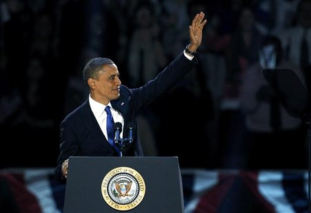 U.S. President Barack Obama, who won a second term in office by defeating Republican presidential nominee Mitt Romney, waves before addressi