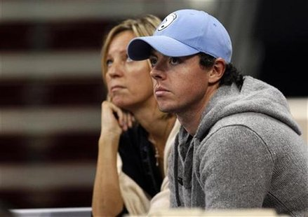 Golfer Rory McIlroy watches from the stands the WTA Tournament of Champions final match between Caroline Wozniacki of Denmark and Nadia Petr