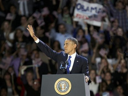 U.S. President Barack Obama acknowledges supporters while at his election night victory rally in Chicago, November 7, 2012. REUTERS/Philip S