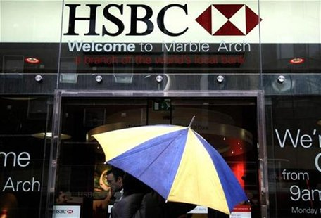 A customer enters a branch of HSBC bank in central London November 8, 2008. REUTERS/Luke MacGregor