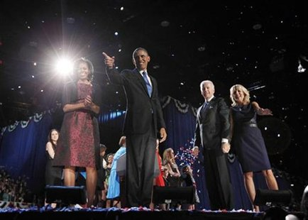 U.S. President Barack Obama (2nd L) celebrates with his wife Michelle, his Vice President Joe Biden and Biden's wife Jill (L-R) after winnin