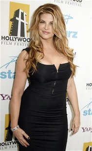 Actress Kirstie Alley, who was a presenter at the Hollywood Awards gala held by the Hollywood Film Festival, poses backstage in Beverly Hill
