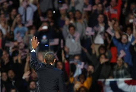 U.S. President Barack Obama acknowledges supporters while addressing his election night victory rally in Chicago, November 7, 2012. REUTERS/