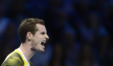 Britain's Andy Murray reacts after losing a point to Serbia's Novak Djokovic during their men's singles tennis match at the ATP World Tour F