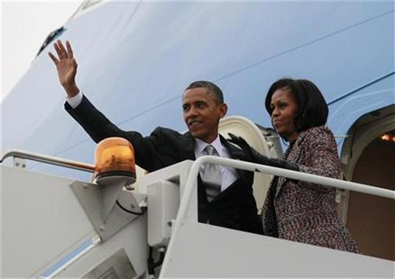 U.S. President Barack Obama and first lady Michelle Obama wave from Air Force One in Chicago, November 7, 2012 following the U.S. presidenti