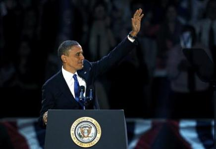 U.S. President Barack Obama, who won a second term in office by defeating Republican presidential nominee Mitt Romney, waves before addressing supporters during his election night victory rally in Chicago, November 7, 2012. Credit: Reuters/Jeff Haynes