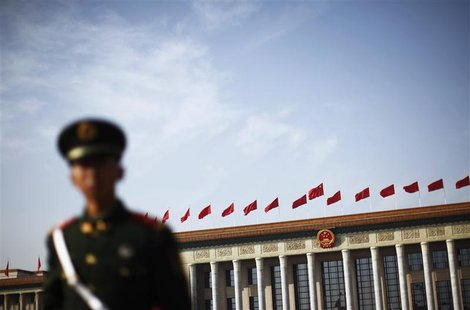 A police officer stands guard in front of the Great Hall of the People at Beijing's Tiananmen Square, November 7, 2012. REUTERS/Carlos Barri