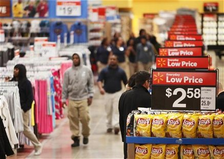 Workers walk through a new Wal-Mart store in Chicago, January 24, 2012. REUTERS/John Gress