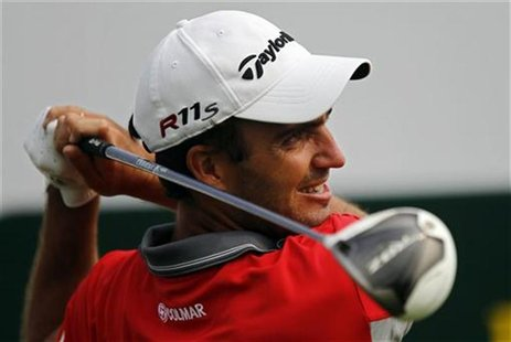 Edoardo Molinari of Italy watches his shot on the first hole during the BMW Masters 2012 golf tournament at Lake Malaren Golf Club in Shangh