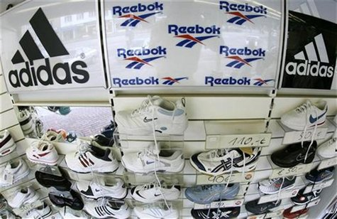 Sport shoes are displayed in a store in the northern German town of Hamburg August 3, 2005.