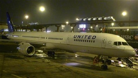 A United Airlines airplane painted in its new corporate logo sits at a gate at Liberty International Airport in Newark, New Jersey, February