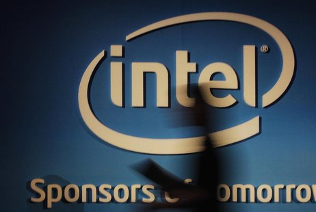A woman walks past an Intel logo at the 2012 Computex in Taipei June 5, 2012. Computex, the world's second largest consumer electronics trad