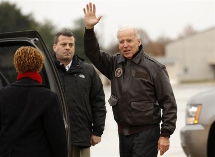 U.S. Vice President Joe Biden waves upon his arrival in Wilmington, Delaware November 7, 2012. Biden will spend the night at his home here b
