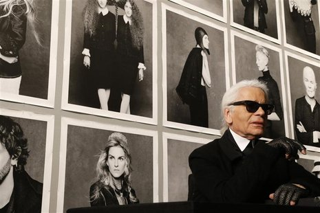 "Chanel's creative director Karl Lagerfeld poses before the opening of his photo exhibition entitled ""Little Black Jacket"" at the Grand Palai"