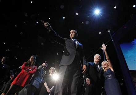 U.S. President Barack Obama gestures onstage during his election night victory rally in Chicago November 7, 2012. Beside Obama are Vice Pres