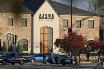 Authorities on the scene of a shooting that killed three people and wounded four others at Azana Salon and Span in Brookfield on October 21, 2012.
