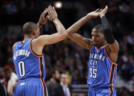 Oklahoma City Thunder point guard Russell Westbrook (0) and Kevin Durant (35) celebrates after a made basket against the Chicago Bulls durin