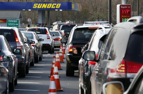 Cars wait in long lines at a Sunoco gas station on the Garden State Parkway in Montvale, New Jersey in this November 1, 2012, file photo. RE