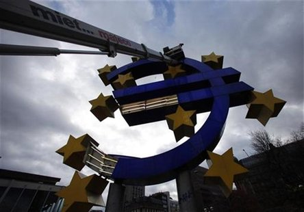 Workers maintain the huge Euro logo next to the headquarters of the European Central Bank (ECB) in Frankfurt, December 6, 2011. REUTERS/Ralp