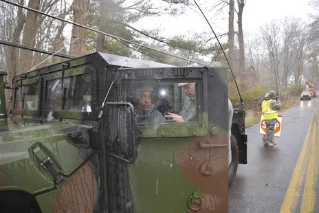 New York Air National Guardsmen guard downed power lines in Westchester County, New York in the aftermath of severe storm damage caused by H