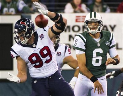 Houston Texans defensive end J.J. Watt (99) blocks a pass by New York Jets quarterback Mark Sanchez (6) in the fourth quarter of their NFL f
