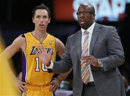 Los Angeles Lakers coach Mike Brown (R) chats to Steve Nash of Canada during their loss to the Dallas Mavericks in their NBA basketball game