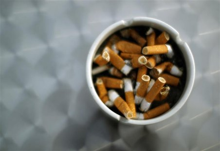 An ash tray with cigarette butts is pictured in Hinzenbach, in the Austrian province of Upper Austria, February 5, 2012. REUTERS/Lisi Niesne