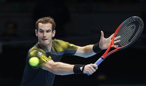 Britain's Andy Murray hits a return to France's Jo-Wilfried Tsonga during their men's singles tennis match at the ATP World Tour Finals at t