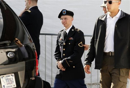Army Private First Class Bradley Manning (C) is escorted in handcuffs as he leaves the courthouse in Fort Meade, Maryland in this June 6, 20