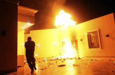 The U.S. Consulate in Benghazi is seen in flames during a protest by an armed group said to have been protesting a film being produced in th