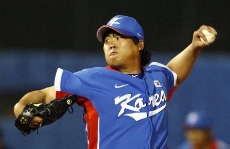 South Korea starting pitcher Ryu Hyun-jin pitches to Taiwan in the baseball final at the 16th Asian Games in Guangzhou, Guangdong province,