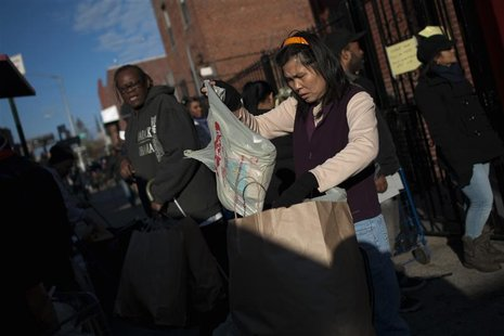 Residents displaced by Hurricane Sandy wait in a line for food and clothing distribution in the Brooklyn Borough of New York, November 9, 20