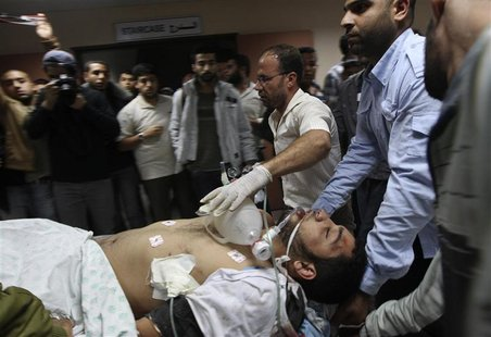 A wounded Palestinian is wheeled on a stretcher at a hospital in Gaza City following Israeli shelling November 10, 2012. REUTERS/Mohammed Sa