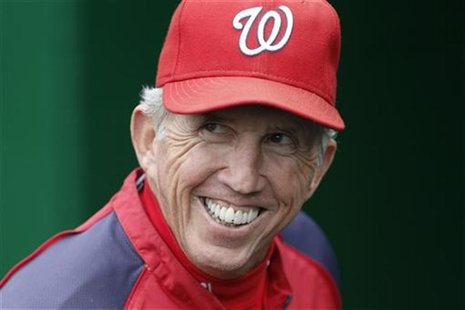 Washington Nationals manager Davey Johnson smiles on the field before his team's MLB National League baseball game against the Philadelphia