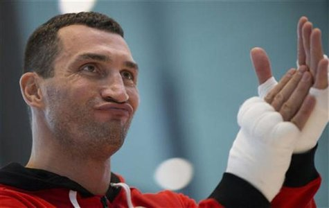 Ukrainian WBO, IBO and IBF heavy weight boxing world champion Vladimir Klitschko reacts during a public training session in Hamburg November