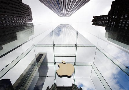 The Apple logo hangs in a glass enclosure above the 5th Ave Apple Store in New York, September 20, 2012. Apple's iPhone 5 goes on sale tomor