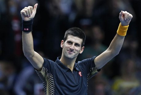Serbia's Novak Djokovic celebrates his win against Argentina's Juan Martin Del Potro after their men's singles semifinal tennis match at the