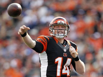 Cincinnati Bengals quarterback Andy Dalton (14) throws under pressure from New York Giants during the first half of play in their NFL footba