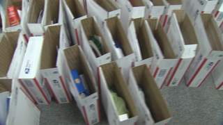 Care packages being assembled for troops in Afghanistan by Prevea Health employees. (courtesy of FOX 11).