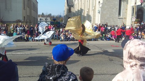 Whirling dancers entertain the crowds at the 51st Annual Holiday Parade.