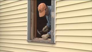 Repairs made to Menasha veteran John Josephs' home Saturday thanks to Habitat for Humanity and the Home Depot Foundation. (courtesy of FOX 11).