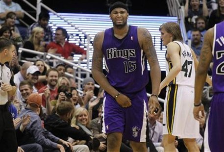 Sacramento Kings forward DeMarcus Cousins (15) holds his groin after getting hit by a ball during the second half of their NBA basketball ga